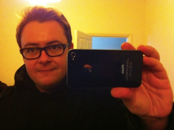 Professional photographers like me may notice the novelty, oversize iPhone next to my head