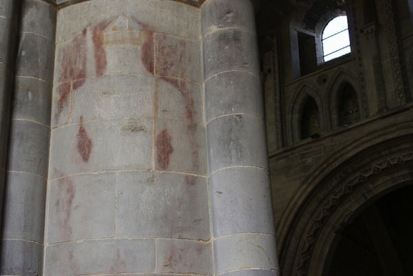 'The Ghostly King'. Believed to be Henry IV, he appeared when the paint was removed from the pillars. He'd been covered up.